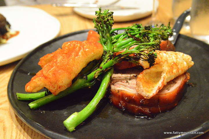 Wood Roasted Suckling Pig witn Stuffing, Broccolini, Chilli Burnt Butter