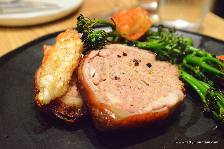 Wood Roasted Suckling Pig with Stuffing, Broccolini, Chilli Burnt Butter