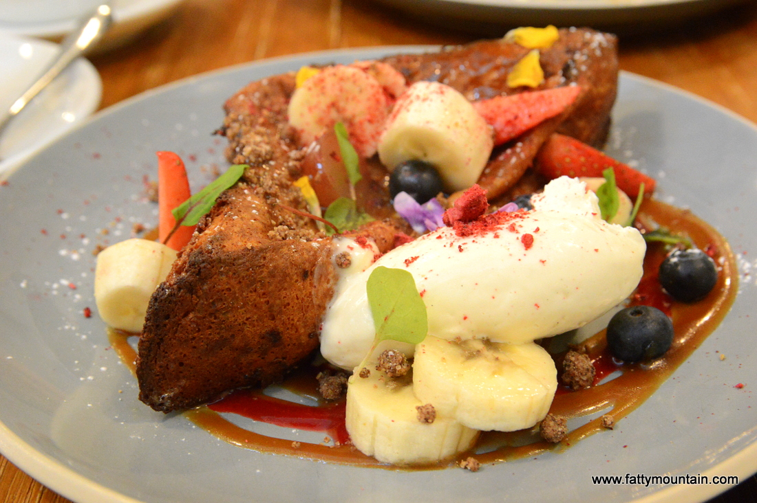 Brioche french toast, salted mascarpone, caramel beurre, cinnamon soil and berries coulis